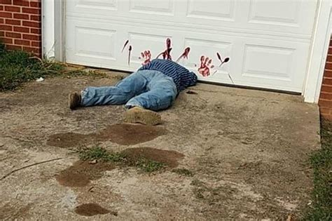 Look Dead Body Halloween Decoration Prompts 911 Calls