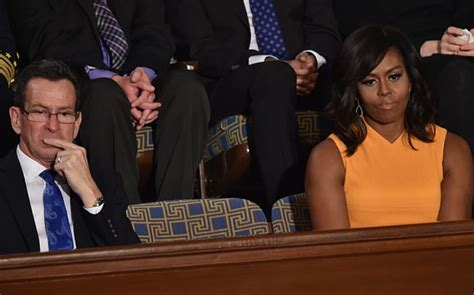 empty seat left beside michelle obama at state of the