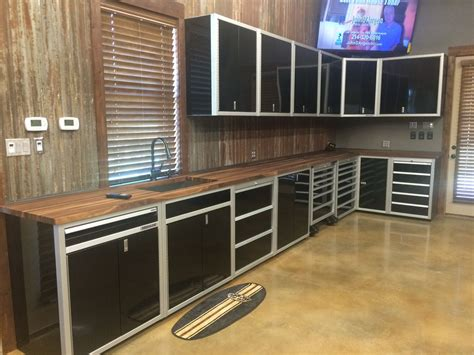 Garage Cabinets And Countertops by Moduline Cabinets In A Garage In Black Aluminum