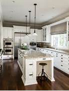Interior Designers Decorators Grey And White Kitchen Has A Mustard Yellow Glass Splashback And White The Cabinetry Here Is Interesting Jumping From White To Grey To Blue Gray And White Kitchens Design Pictures Remodel Decor And Ideas