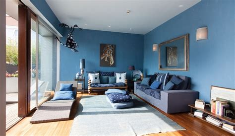 blue livingroom creating a warm and calm situation at home with blue accent wall