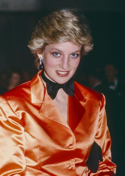 princess diana princess diana wearing an orange jacket and bow tie photo