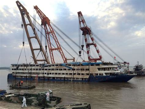 Destination Crab Boat Recovery by Crane Lifts Ship Out Of Yangtze River
