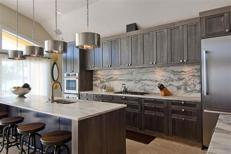 gray cabinets marble backsplash  contemporary kitchen