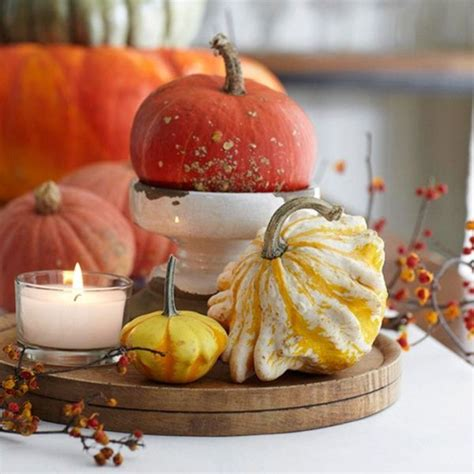 how to decorate a table for fall using gourds for a fall inspired dining table centerpiece