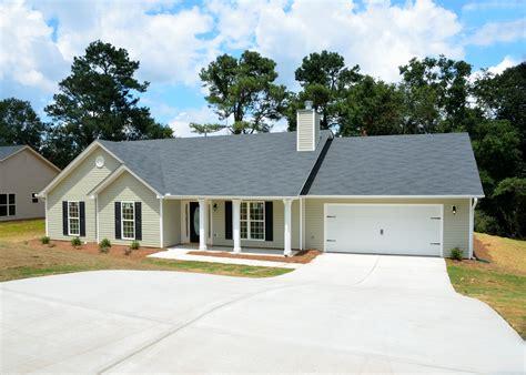 gray 2 storey house at daytime 183 free