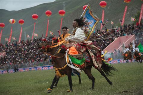 tibetan horsemen ride  traditional dress