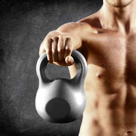 lifting weight kettlebell fitness dumbbell training bell muscular kettle male torso shirtless close crossfit preview