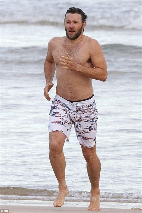 Joel Edgerton shirtless as he strips down to swimming ...