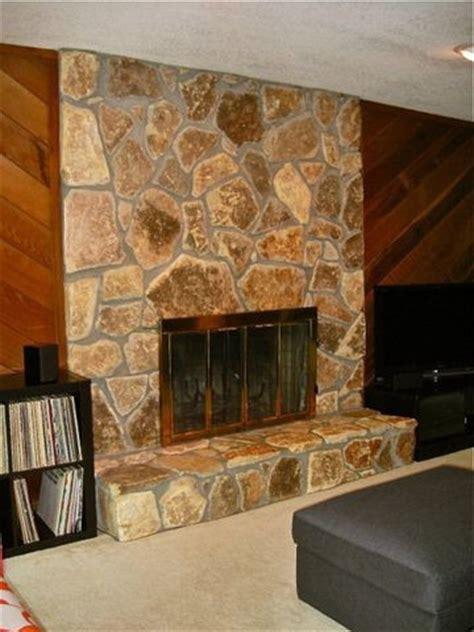 cedar plank wall  light stone fireplace  house