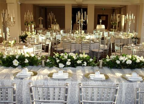 Candelabra Centerpieces With Greenery