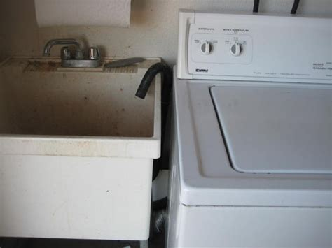 washing machine drains into sink dealing with dirty laundry at a home inspection