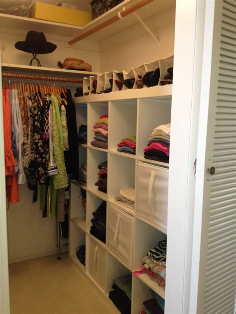 small closet organization ideas with brown solid wood