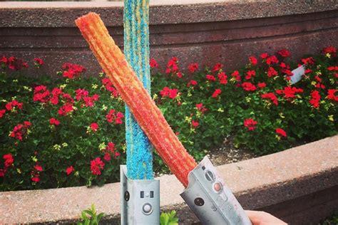 Disney Light Saber by Disneyland S New Lightsaber Churros Will Make You A Snack