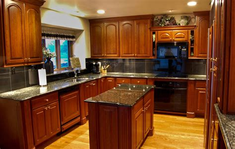 cherry wood cabinets with granite countertop furniture light wood flooring with black granite