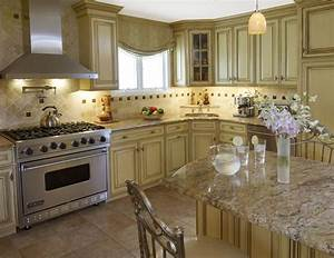 brown kitchen cabinets with cream island quicuacom With cream and brown kitchen designs