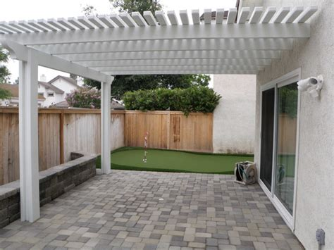 paver patio with putting green and patio cover