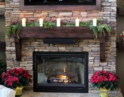 christmas mantel decorated  pine garland  pillar