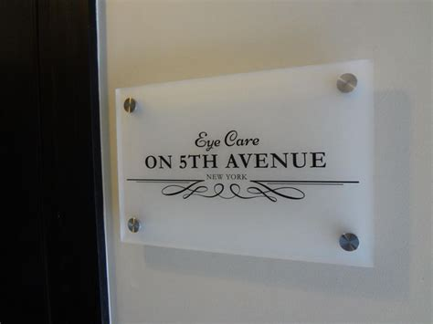 frosted acrylic sign panel  custom die cut adhesive vinyl lettering  opaque black mounted