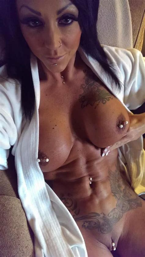 Ashton Shows Off Ink And Studs Xxx Photo