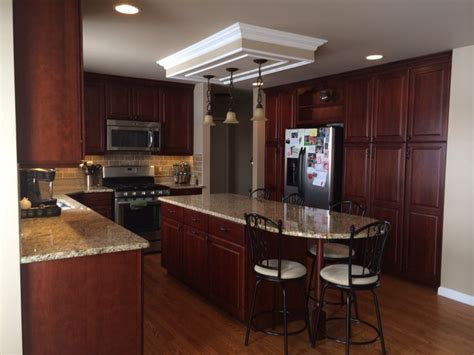 my new kitchen dynasty omega cabinet in brookshire cherry with venetian gold granite