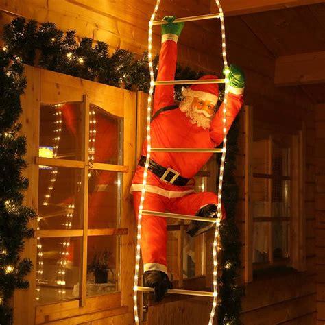 Weihnachtsdekoration Außenbereich by Weihnachtsmann Nikolaus Santa Claus An Der Leiter
