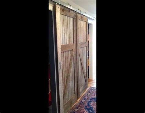 barn doors with tin panels an idea for our patio one door