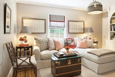 Neutral TV room with BM Ashley Gray Walls, pops of Orange ...