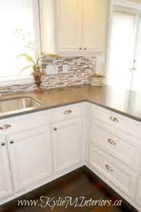 small tile backsplash in kitchen kitchen and glazed cabinets small mosaic tile backsplash and wood floors