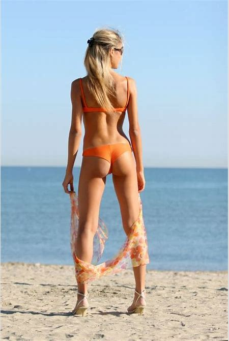 Woman Beautiful | Free Stock Photo | A girl in an orange bikini standing on the beach | # 5493