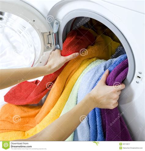 Woman Taking Clothes From Washing Machine Stock Image