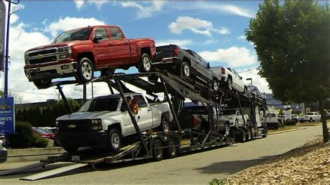 auto transport carrier quick unload gm car pickup
