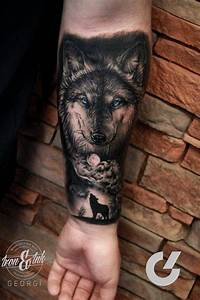 Black and grey style wolf tattoo on the left inner forearm ...