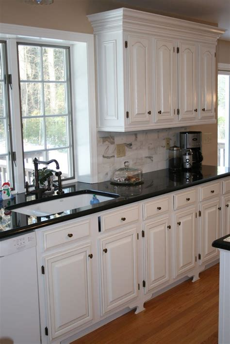 kitchen cabinet tops white cabinets black countertops and that faucet home 2812