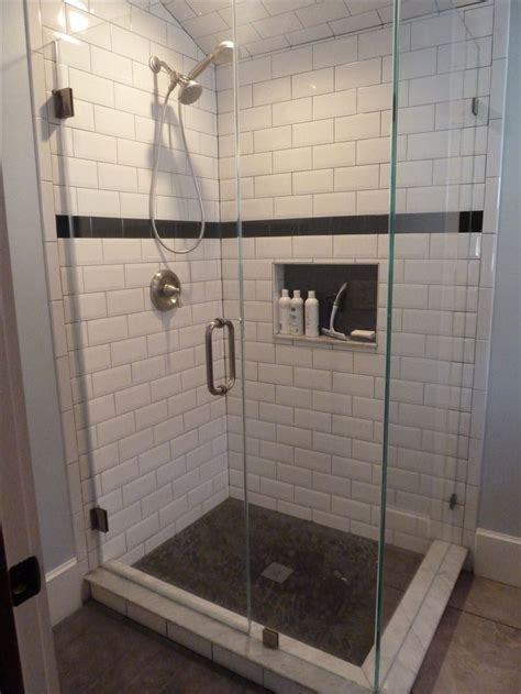 large beveled subway tile  smaller black subway tile