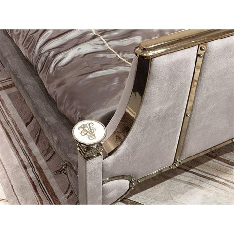 cloud 7 sofa upholstered in shimmering silver grey velour upholstered chrome brass bedstead