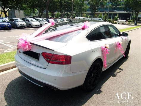 white audi s5 wedding car decorations by ace car rental