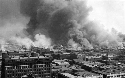 Smoke rises from buildings during the 1921 race massacre in tulsa, oklahoma. Tulsa race riot - Wikipedia