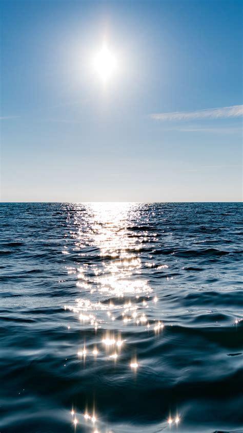 wallpaper sun  blue sky  reflected  water