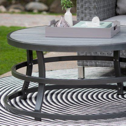 For longer sofas, oval tables can be a smart choice. Belham Living Sona Faux Wood Round Outdoor Coffee Table ...