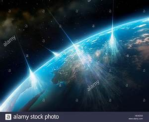 Cosmic rays.Artwork of high-energy particles radiation ...
