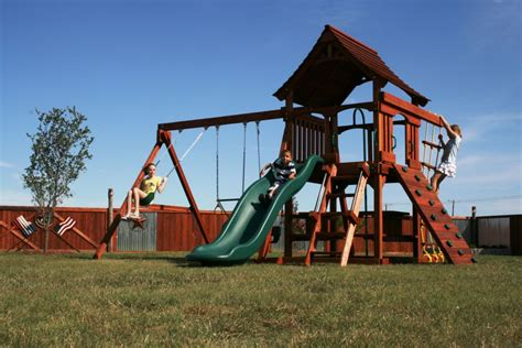The Backyard Factory by Backyard Factory Swing Sets Fenceworks