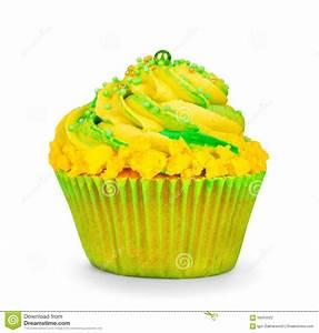 Yellow Birthday Cupcake With Green Cream Stock Photo ...
