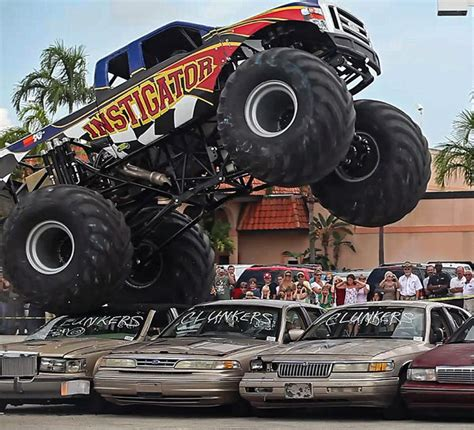 monster truck videos crashes monster trucks crashes over cash 4 clunkers cars