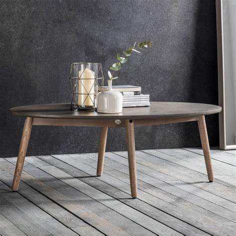 Coffee tables were first invented when a typical table was shortened to hold beverages for guests, or so the story goes. Brooklyn Oval Coffee Table Concrete | Modern Coffee & Side Tables