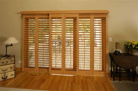 wood shutters a sliding door sunburst shutters