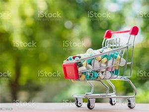 Shopping Trolley Full Of Medicine With Pills And Capsules On Bokeh Background Healthy And