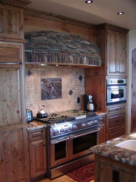 Rustic Range Hood And Stone Backsplash Kitchen