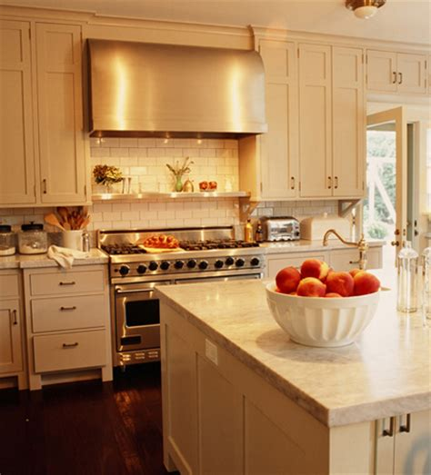 white or cream kitchen cabinets cream wood panel kitchen hood design ideas
