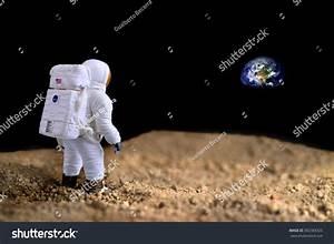 American Astronaut On Moon Looking Earth Stock Photo ...